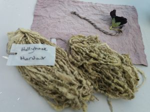 Sheep's fleece and cotton naturally dyed green and purple shades with Black Hollyhock flowers