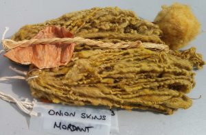 Sheep's fleece and cotton thread naturally dyed orange with onion skins